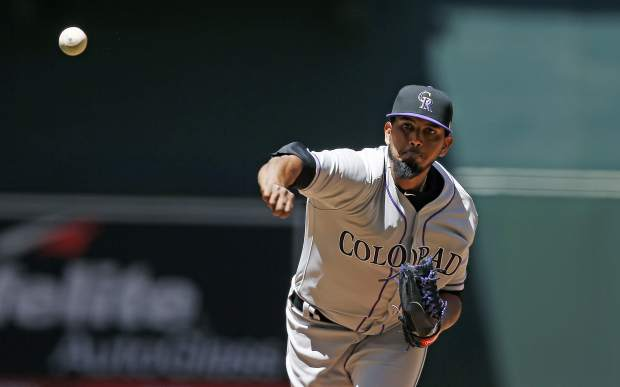 Colorado Rockies' German Marquez throws against the Arizona Diamondbacks during the first inning of a baseball game, Sunday, April 30, 2017, in Phoenix. (AP Photo/Ross D. Franklin)