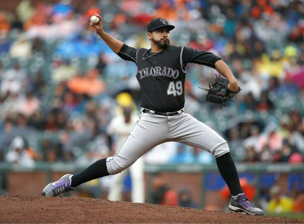 Colorado Rockies starting pitcher Antonio Senzatela (49) throws to the San Francisco Giants during the second inning of a baseball game, Sunday, April 16, 2017, in San Francisco. (AP Photo/Tony Avelar)