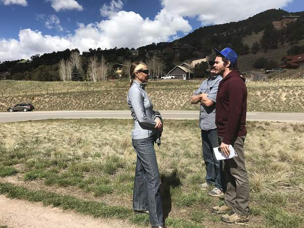 Basalt Public Arts Commission's Nancy Lovendahl and Glenn Smith speak to artist Wynn Earl Buzzell Jr. during a Wednesday site visit in Basalt. A group toured propsed sites for Buzzell's sculpture, which will be installed in June.