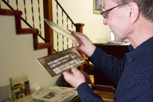 Post Independent Editor and Publisher Randy Essex gets the first look at old contact sheets that the paper's long-sealed safe had been hiding.