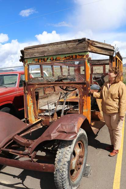 Re-2 Director of Transportation Sanja Morgan stands next to the 1932 Ford school that she one day hopes to restore.