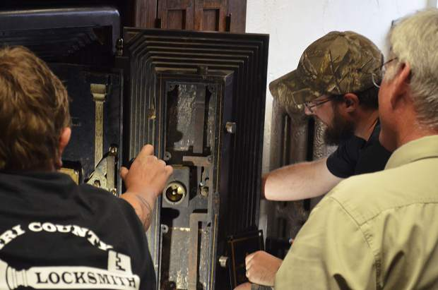 Locksmith Wayne Winton and partners get a first look inside a large Mosler safe at the Post Independent's offices.