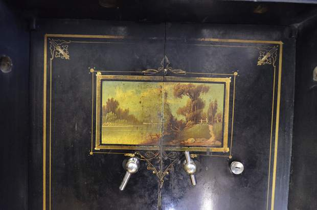 The interior door of a safe at the Post Independent features ornate painting charateristic of vintage Mosler safes.