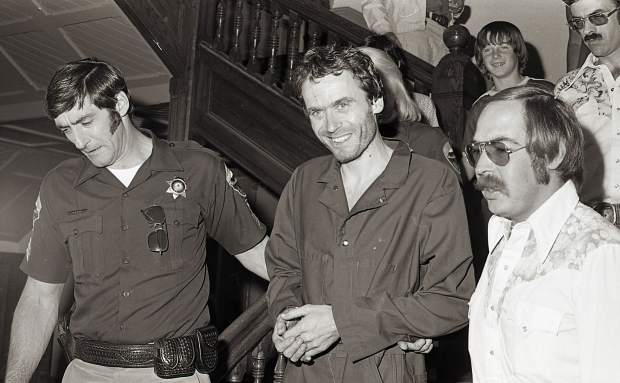 In 1977, the serial murderer Ted Bundy is escorted out of court at the Pitkin County Courthouse, having just been captured after six days on the run when he escaped the same courthouse. The Post Independent recently had its long-sealed safe opened by a locksmith, revealing numerous old photo negatives, including this one.