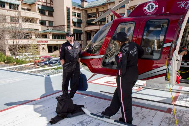 Pilot Coby Brown and flight nurse Stacy Lawson chat on the helipad at Valley View Hospital.