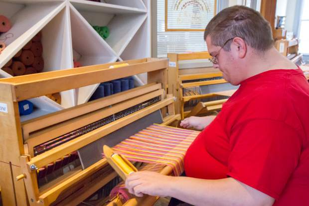 Brian Wilson works at both the Habitat for Humanity ReStore and as a weaver at Art on Eight.