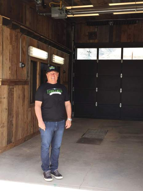 CEO Mark Smith stands outside what will be the first drive-thru retail marijuana store in the state.