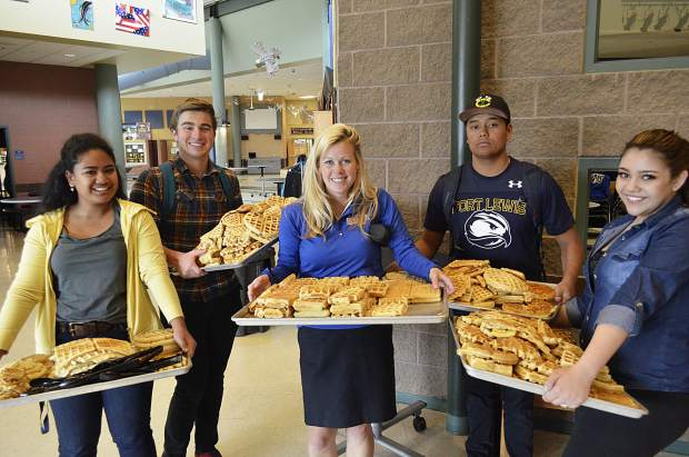 Roaring Fork High School students had plenty of waffles to eat at a protest-turned-celebration, sparked by tensions in the student body after the school district passed on their beloved assistant principal Kelsie Goodman, center, for the principal's position. Pictured with Goodman, from left, Isak Resnick, Wes Engstrom, Durga Reed and Jennifer Rios.