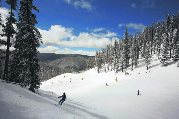 Skiers and snowboarders enjoy spring conditions on Keystone Resort's Mozart run in late March. The popular Summit County ski area has experienced 22 accidental fatalities since the 2006-07 season, which leads the state over that period.