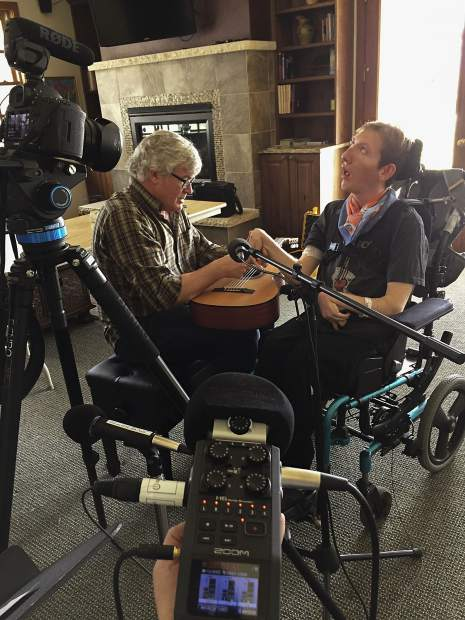 Grange being filmed with longtime local musician Mack Bailey for