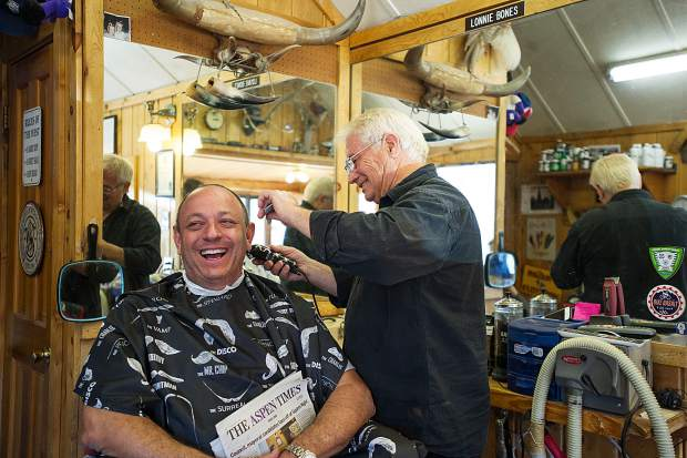 Scott Picard shares a laugh with Lonnie Bones. Half the fun of a haircut at Basalt Barber Shop is shooting the bull with Lonnie and his son and fellow barber Chad Bones.