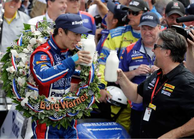 Takuma Sato, left, of Japan, toasts with car owner Michael Andretti as they celebrate after winning the Indianapolis 500 auto race at Indianapolis Motor Speedway, Sunday, May 28, 2017, in Indianapolis. (AP Photo/Darron Cummings)