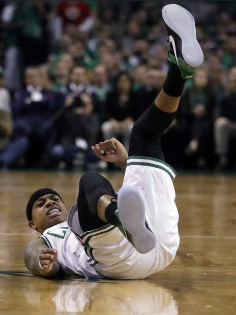 Boston Celtics guard Isaiah Thomas ends up on his back after a collision during the first quarter of Game 7 of a second-round NBA basketball playoff series against the Washington Wizards, Monday, May 15, 2017, in Boston. (AP Photo/Charles Krupa)