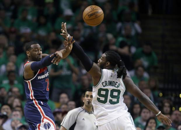 Washington Wizards guard John Wall, left, delivers a pass as Boston Celtics forward Jae Crowder defends during the second quarter of Game 7 of a second-round NBA basketball playoff series, Monday, May 15, 2017, in Boston. (AP Photo/Charles Krupa)