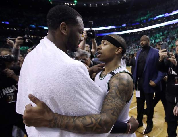 Washington Wizards guard John Wall, left, and Boston Celtics guard Isaiah Thomas speak on the court after Game 7 of a second-round NBA basketball playoff series, Monday, May 15, 2017, in Boston. The Celtics won 115-105 to advance to the Eastern Conference championship series. (AP Photo/Charles Krupa)