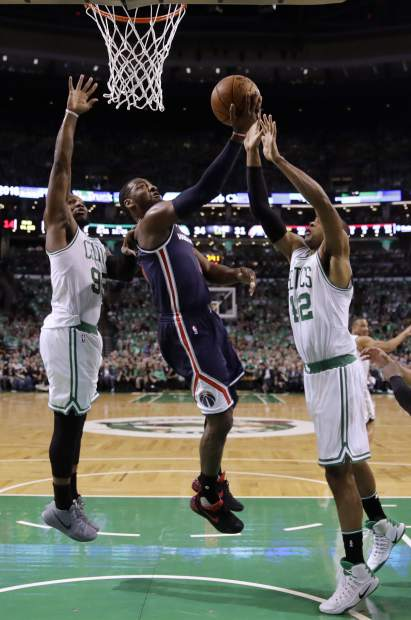 Washington Wizards guard John Wall, center, drives between Boston Celtics forward Jae Crowder, left, and center Al Horford during the second quarter of Game 7 of a second-round NBA basketball playoff series, Monday, May 15, 2017, in Boston. (AP Photo/Charles Krupa)