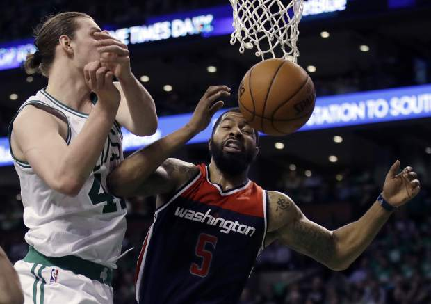 Washington Wizards forward Markieff Morris (5) and Boston Celtics center Kelly Olynyk, left, fight for a rebound during the second quarter of Game 7 of a second-round NBA basketball playoff series, Monday, May 15, 2017, in Boston. (AP Photo/Charles Krupa)