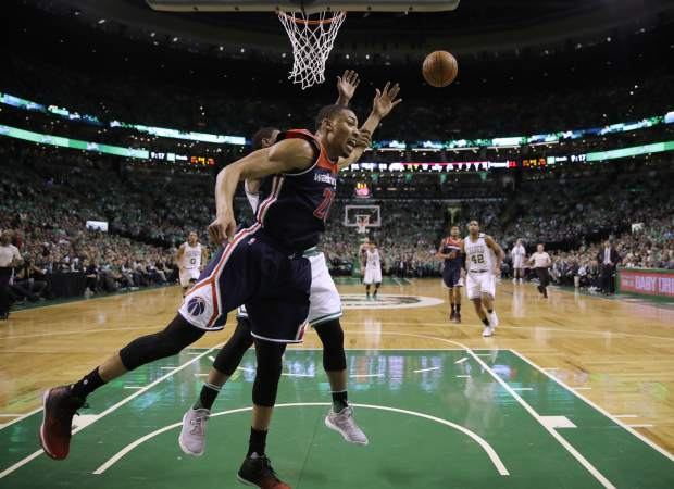 Washington Wizards forward Otto Porter Jr., front, and Boston Celtics guard Marcus Smart, behind, contend for a rebound during the second quarter of Game 7 of a second-round NBA basketball playoff series, Monday, May 15, 2017, in Boston. (AP Photo/Charles Krupa)