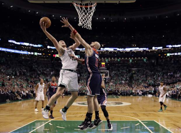 Boston Celtics center Kelly Olynyk (41) drives against Washington Wizards center Marcin Gortat (13) during the fourth quarter of Game 7 of a second-round NBA basketball playoff series, Monday, May 15, 2017, in Boston. (AP Photo/Charles Krupa)