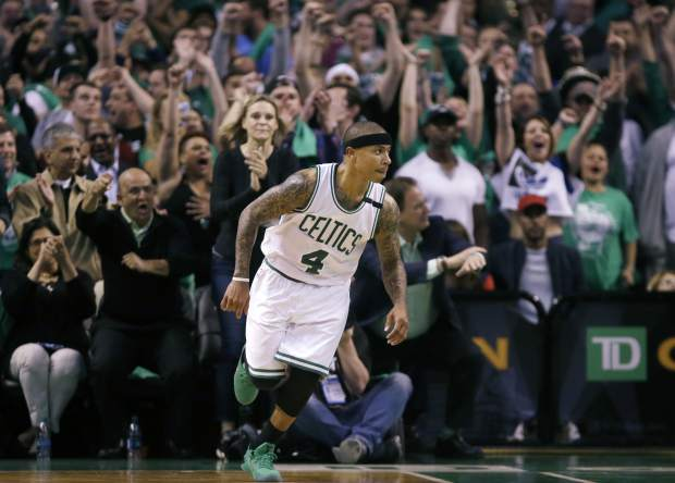 Boston Celtics fans cheer as guard Isaiah Thomas runs up court after a made basket during the fourth quarter of Game 7 of a second-round NBA basketball playoff series against the Washington Wizards, Monday, May 15, 2017, in Boston. (AP Photo/Charles Krupa)