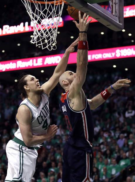 Washington Wizards center Marcin Gortat, right, shoots as Boston Celtics center Kelly Olynyk defends during the fourth quarter of Game 7 of a second-round NBA basketball playoff series, Monday, May 15, 2017, in Boston. (AP Photo/Charles Krupa)