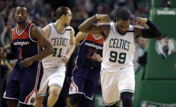 Boston Celtics forward Jae Crowder (99) celebrates his basket against the Washington Wizards during the fourth quarter of Game 7 of a second-round NBA basketball playoff series, Monday, May 15, 2017, in Boston. (AP Photo/Charles Krupa)