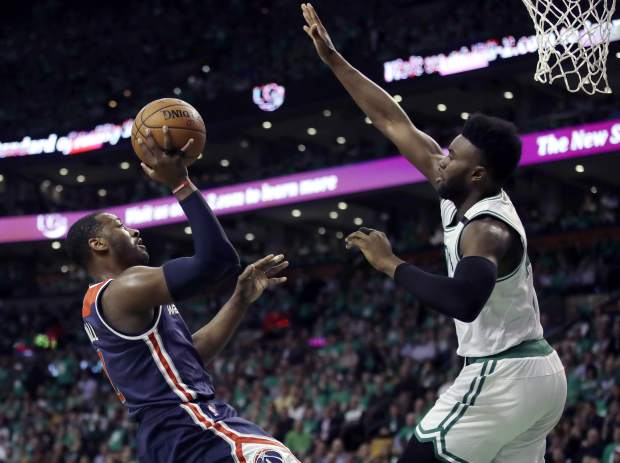 Washington Wizards guard John Wall, left, shoots against Boston Celtics forward Jaylen Brown during the third quarter of Game 7 of a second-round NBA basketball playoff series, Monday, May 15, 2017, in Boston. (AP Photo/Charles Krupa)