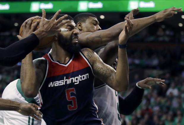 Washington Wizards forward Markieff Morris fights for a rebound against Boston Celtics guard Marcus Smart, rear, during the third quarter of Game 7 of a second-round NBA basketball playoff series, Monday, May 15, 2017, in Boston. (AP Photo/Charles Krupa)