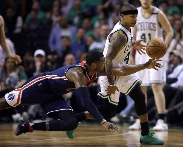 Boston Celtics guard Isaiah Thomas (4) drives past Washington Wizards guard John Wall during the third quarter of Game 7 of a second-round NBA basketball playoff series, Monday, May 15, 2017, in Boston. (AP Photo/Charles Krupa)