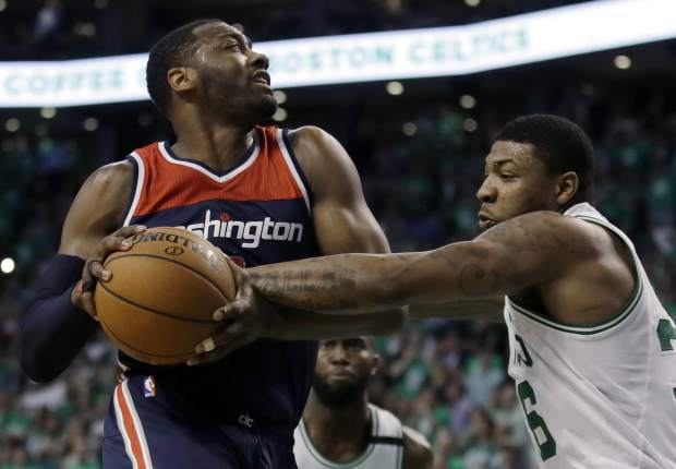 Washington Wizards guard John Wall, left, drives against Boston Celtics guard Marcus Smart during the third quarter of Game 7 of a second-round NBA basketball playoff series, Monday, May 15, 2017, in Boston. (AP Photo/Charles Krupa)