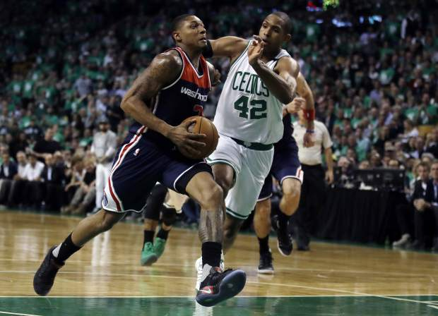 Washington Wizards guard Bradley Beal, left, drives past Boston Celtics center Al Horford (42) during the third quarter of Game 7 of a second-round NBA basketball playoff series, Monday, May 15, 2017, in Boston. (AP Photo/Charles Krupa)