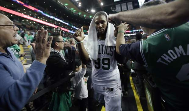 Fans congratulate Boston Celtics forward Jae Crowder after Game 7 of a second-round NBA basketball playoff series, Monday, May 15, 2017, in Boston. The Celtics won 115-105 to advance to the Eastern Conference championship series. (AP Photo/Charles Krupa)