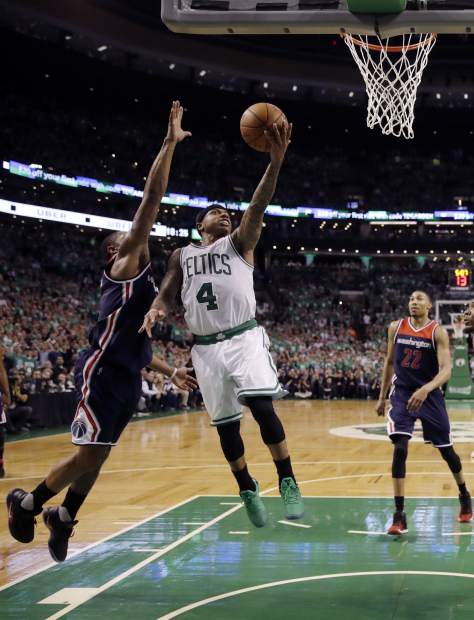 Boston Celtics guard Isaiah Thomas (4) drives to the basket against the Washington Wizards during the fourth quarter of Game 7 of a second-round NBA basketball playoff series, Monday, May 15, 2017, in Boston. (AP Photo/Charles Krupa)