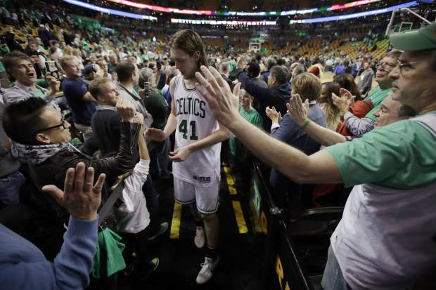 Fans congratulate Boston Celtics center Kelly Olynyk after Game 7 of a second-round NBA basketball playoff series, Monday, May 15, 2017, in Boston. The Celtics won 115-105 to advance to the Eastern Conference championship series. (AP Photo/Charles Krupa)