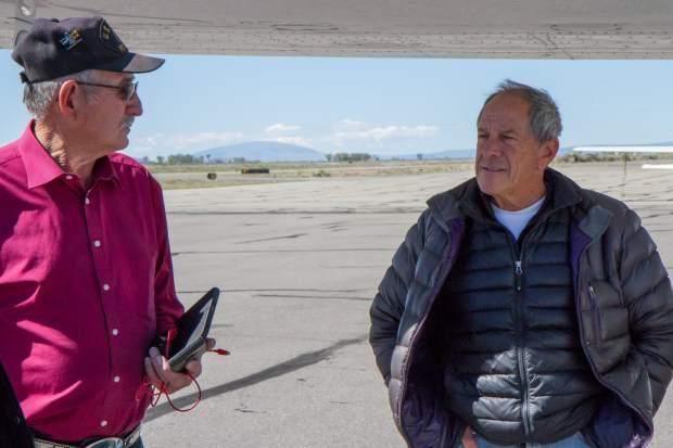 EcoFlight pilot and founder Bruce Gorden speaks with a fellow veteran before taking a flight over the Alamosa Wildlife Refuge, Blanco Wetlands and Rio Grand del Norte National Monument.