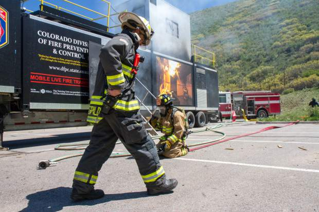 Glenwood Springs firefighters started training Thursday on a state-owned mobile training unit mounted on a 55-foot semi trailer that will be in town for a couple of weeks. It unpacks into a second story with balconies and railings so firefighters can practice laddering and rescue as well as firefighting. Propane burners are mounted throughout the Colorado Division of Fire Prevention and Control structure to simulate different fire and heat conditions, said Fire Chief Gary Tillotson. Tillotson expected other local fire departments to come to Glenwood over the next couple weeks to use the training unit in some joint exercises. Having a mobile tool for required annual training is valuable, said the fire chief. It allows the department to avoid overtime and keeping firefighters available for emergencies.