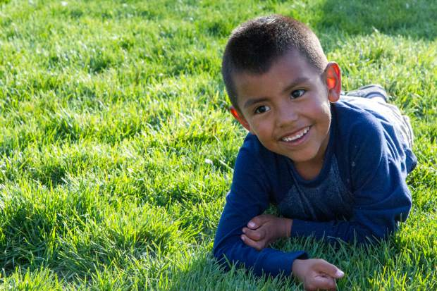 Eduardo Villa, 5, plays in the grass with friends at the Festival Las Americas on Friday evening.