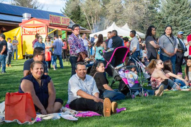 Festival goers enjoy music in Sopris Park at the Festival Las Americas.