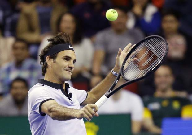FILE - In this April 29, 2017, file photo, Roger Federer, of Switzerland, returns a volley during an exhibition tennis match in Seattle. Roger Federer says he won't play in the French Open and instead prepare to play on grass and hard courts later this season. Federer posted a message entitled