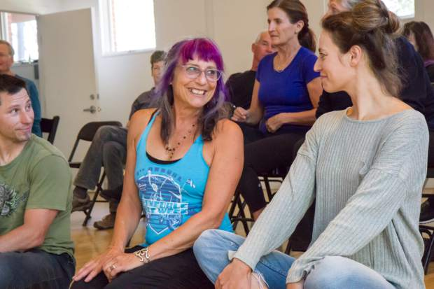 Amy Kimberly and Laura Stover laugh with each other during one of the exercises with the Dance Initiative group on Tuesday evening.