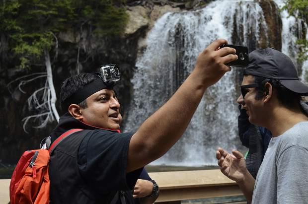Visitors from across the world flock to Hanging Lake, many finding the scenic location through online lists of top places to visit in Colorado. The trail and lake's popularity is an economic driver for nearby communities, but the overwhelming traffic to Hanging Lake is also forcing the U.S. Forest Serviceto look at capping the number of visitors.