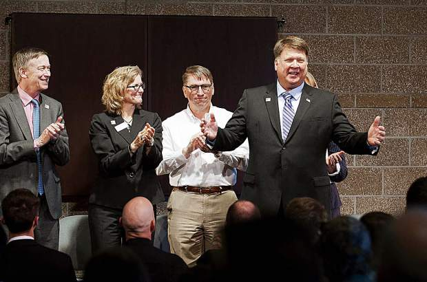 Kevin Brun, who has directed CMC's Colorado Law Enforcement Training Academy for 16 years, will retire later this year. He was given a standing ovation at the academy's graduation ceremony this year. Among those honoring him were, from left, Gov. John Hickenlooper (50th anniversary commencement speaker), CMC President Carrie Besnette Hauser, CMC Board of Trustees Chairman Glenn Davis, and, behid Brun, CMC West Garfield County Trustee Mary Ellen Denomy.