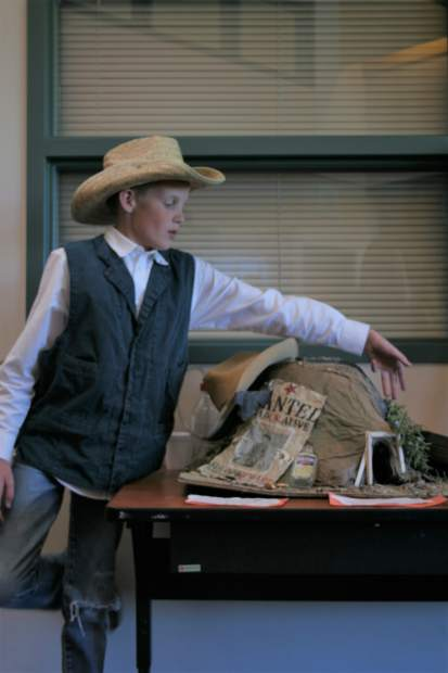 Hundreds of community members stormed into Grand Valley Middle School on Tuesday night to experience the lively museum featuring western expansion exhibits. The exhibits included interactive maps, artifacts, skits, poetry, journal entries, and historical fiction writings on people who impacted western expansion. Tyrell Kitson explains his miner artifact to students, parents, and community members throughout the night.
