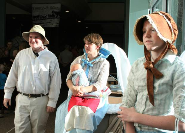 Hundreds of community members stormed into Grand Valley Middle School on Tuesday night to experience the lively museum featuring western expansion exhibits. The exhibits included interactive maps, artifacts, skits, poetry, journal entries, and historical fiction writings on people who impacted western expansion. Emma Whiting, Bailey Hoyt, and Broden Patton perform a skit on the hardships of being a pioneer.