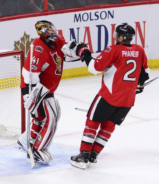 Ottawa Senators goalie Craig Anderson (41) and Senators defenseman Dion Phaneuf (2) celebrate after defeating the Pittsburgh Penguins in game six of the Eastern Conference final in the NHL Stanley Cup hockey playoffs in Ottawa on Tuesday, May 23, 2017. (Sean Kilpatrick/The Canadian Press via AP)