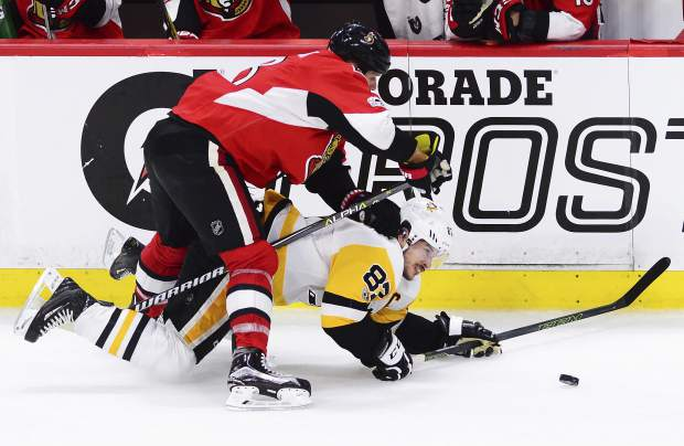 Ottawa Senators defenseman Marc Methot (3) takes down Pittsburgh Penguins center Sidney Crosby (87) during the third period of game six of the Eastern Conference final in the NHL Stanley Cup hockey playoffs in Ottawa on Tuesday, May 23, 2017. (Sean Kilpatrick/The Canadian Press via AP)