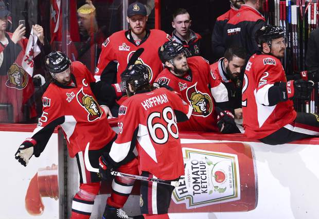 Ottawa Senators left wing Mike Hoffman (68) celebrates his goal against the Pittsburgh Penguins with Erik Karlsson (65) during the third period of Game six of the Eastern Conference final in the NHL Stanley Cup hockey playoffs in Ottawa, Ontario, Tuesday, May 23, 2017. (Sean Kilpatrick