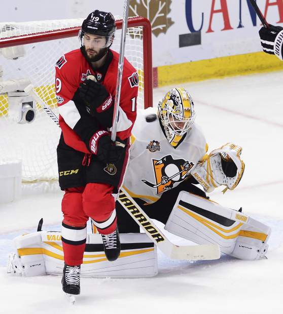 Ottawa Senators centre Derick Brassard (19) braces himself as a shot is fired toward Pittsburgh Penguins goalie Matt Murray (30) during the second period of game six of the Eastern Conference final in the NHL Stanley Cup hockey playoffs in Ottawa on Tuesday, May 23, 2017. (Sean Kilpatrick/The Canadian Press via AP)