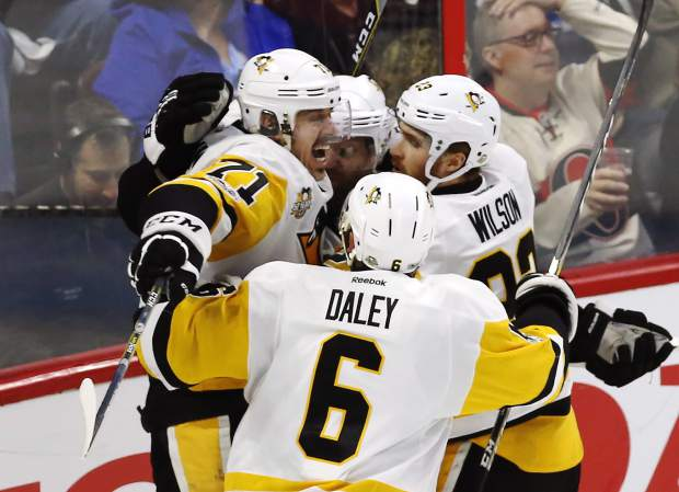 Pittsburgh Penguins center Evgeni Malkin (71) celebrates his goal against the Ottawa Senators with teammates Phil Kessel (81), Trevor Daley (6) and Scott Wilson (23) during the second period of game six of the Eastern Conference final in the NHL Stanley Cup hockey playoffs in Ottawa on Tuesday, May 23, 2017. (Fred Chartrand/The Canadian Press via AP)