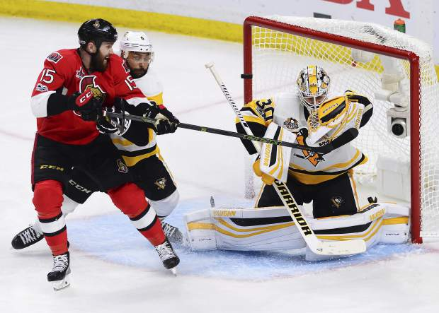 Pittsburgh Penguins goalie Matt Murray (30) makes a save as Ottawa Senators center Zack Smith (15) and Penguins defenseman Trevor Daley (6) battle in front during the third period of Game six of the Eastern Conference final in the NHL Stanley Cup hockey playoffs in Ottawa, Ontario, Tuesday, May 23, 2017. (Sean Kilpatrick/The Canadian Press via AP)
